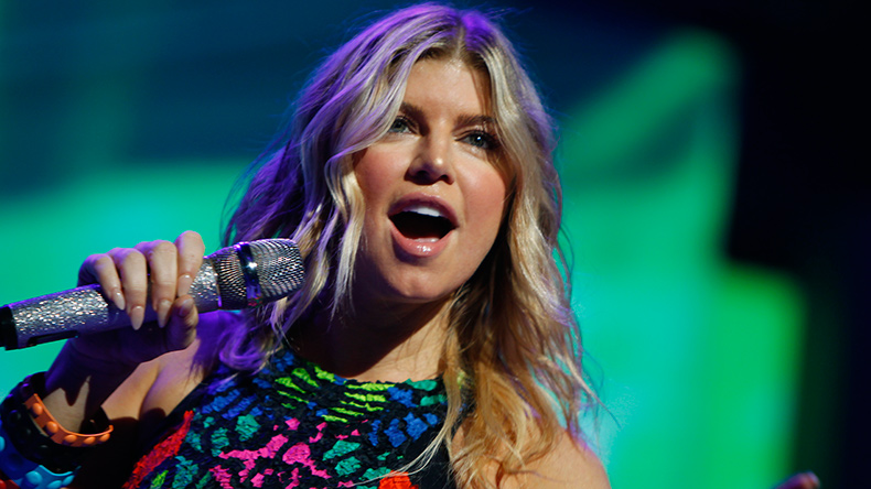 'Life Goes On' singer Fergie flaunts derriere in cheeky image