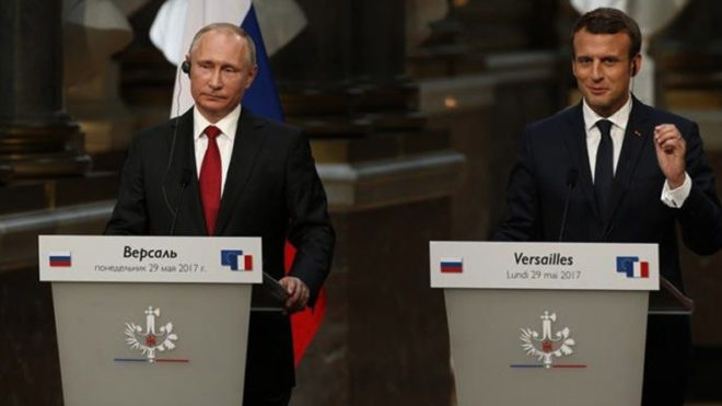 Emmanuel Macron meets Vladimir Putin, warns over Syrian chemical weapons