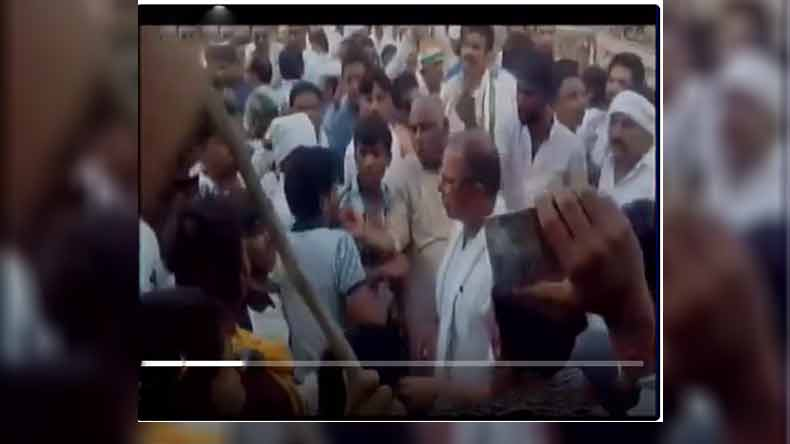 MP Congress leader Ajay Singh slaps party worker during a protest in Sagar