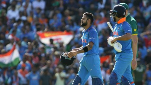 Virat-Kohli-and-Yuvraj-Singh-after-securing-India's-semi-final-birth-9