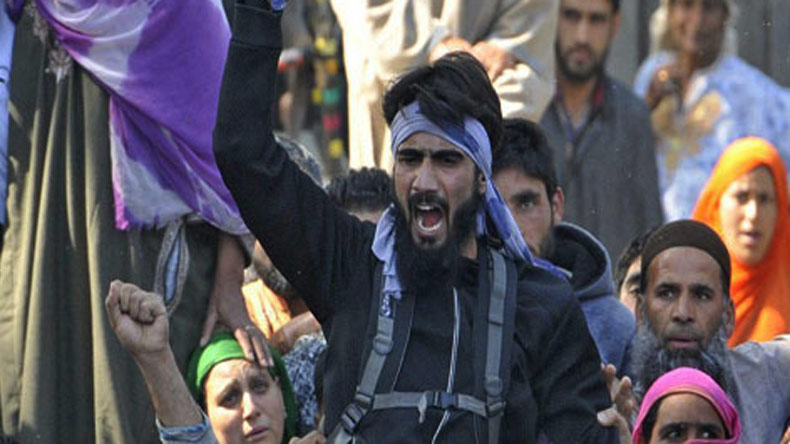 Suspected militant Danish Ahmed, seen at Sabzar Bhat's funeral, surrenders