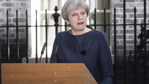 British PM Theresa May issues public apology for Grenfell Tower fire