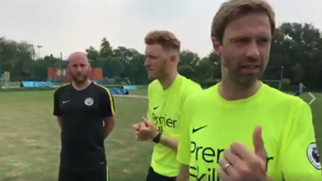 Coach-Jeremy-Weeks-alongside-Manchester-City's-Tom-Hughes,-Elliot-Sutcliffe-discusses-Premier-Skills-with-NewsX