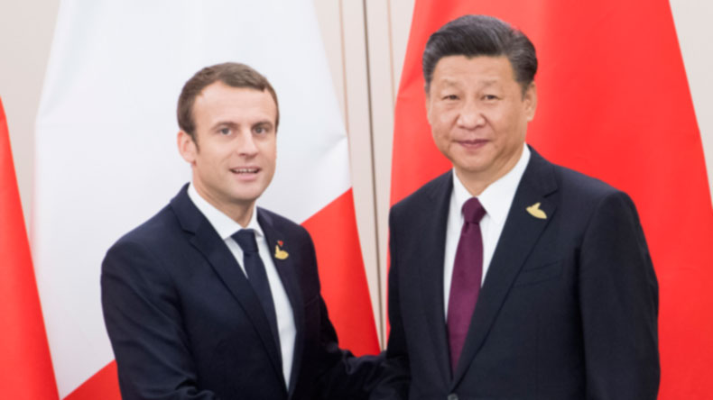 Macron Bizarrely Meanders Through G20 Leaders To Stand Next To Trump