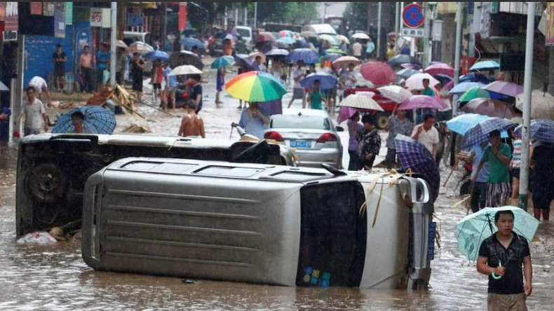 Heavy rains bring record flooding to Central, Southern China