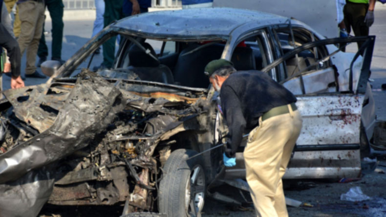 Lahore: July 24, 2017 (Xinhua) A policeman checks a damaged vehicle at the blast site in eastern Pakistan's Lahore, on July 24, 2017. At least 15 people were killed and 22 others injured as a suicide blast hit the downtown area of Pakistan's eastern city