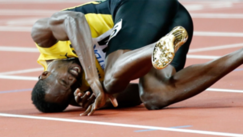 Usain Bolt crashes out in the last race of his career; pulls out injured