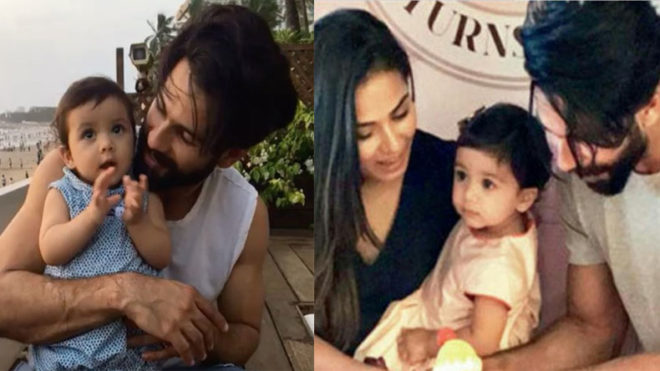 Baby Misha cuts her first birthday cake along with 'Dad' Shahid and 'mom' Mira