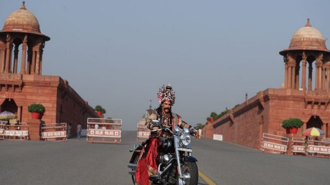 Oops! Rs 100 fine for 'Ravana' for riding a bike with crown instead of helmet
