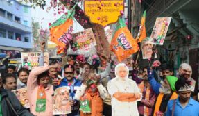 Varanasi: BJP supporters celebrate the party's performance in Himachal Pradesh and Gujarat assembly elections in Varanasi on Dec 18, 2017.  (Photo: IANS)