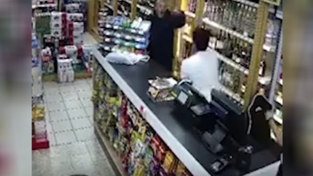 Indian-origin shopkeeper in UK fights off robber with vodka bottle, chair