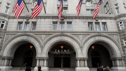 Man with assault rifle arrested at Trump hotel
