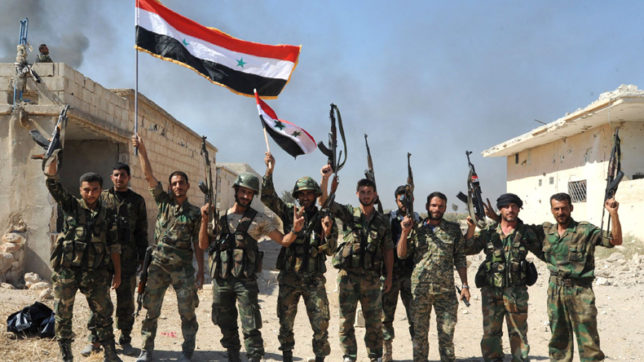 Syrian forces fully besiege last Islamic State stronghold in Homs