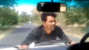 UP Government Official,Car Driven With Man On Bonnet,UP Police,Video Of Man On Bonnet,BDO Drives With Man On Bonnet, India,All India,India,Uttar Pradesh,Lucknow,uttar pradesh government officer, up police, up incident, Regional news, National news, Watch video, video of man holding the bonnet