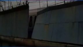 Shiny Delhi Metro stopped because old world wall falls on it