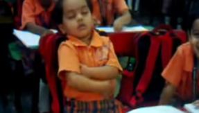 This video of a little girl dozing off in her classroom is the cutest thing ever