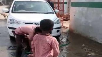 In the video, students of the primary school were captured cleaning the teacher's car
