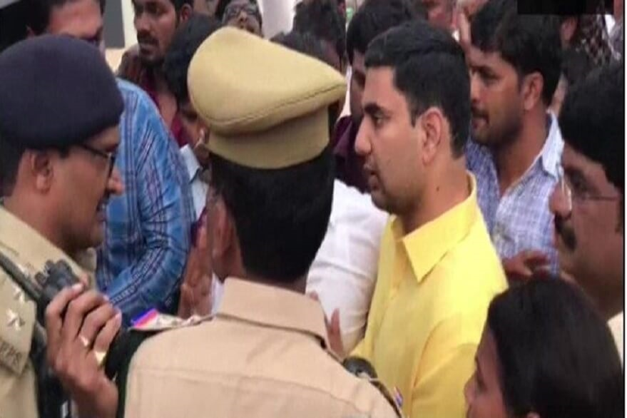 Chandrababu Naidu's son (in yellow T-shirt) Nara Lokesh argues with police